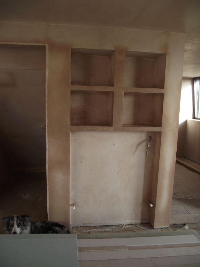 The plastered shelves and radiator recess.